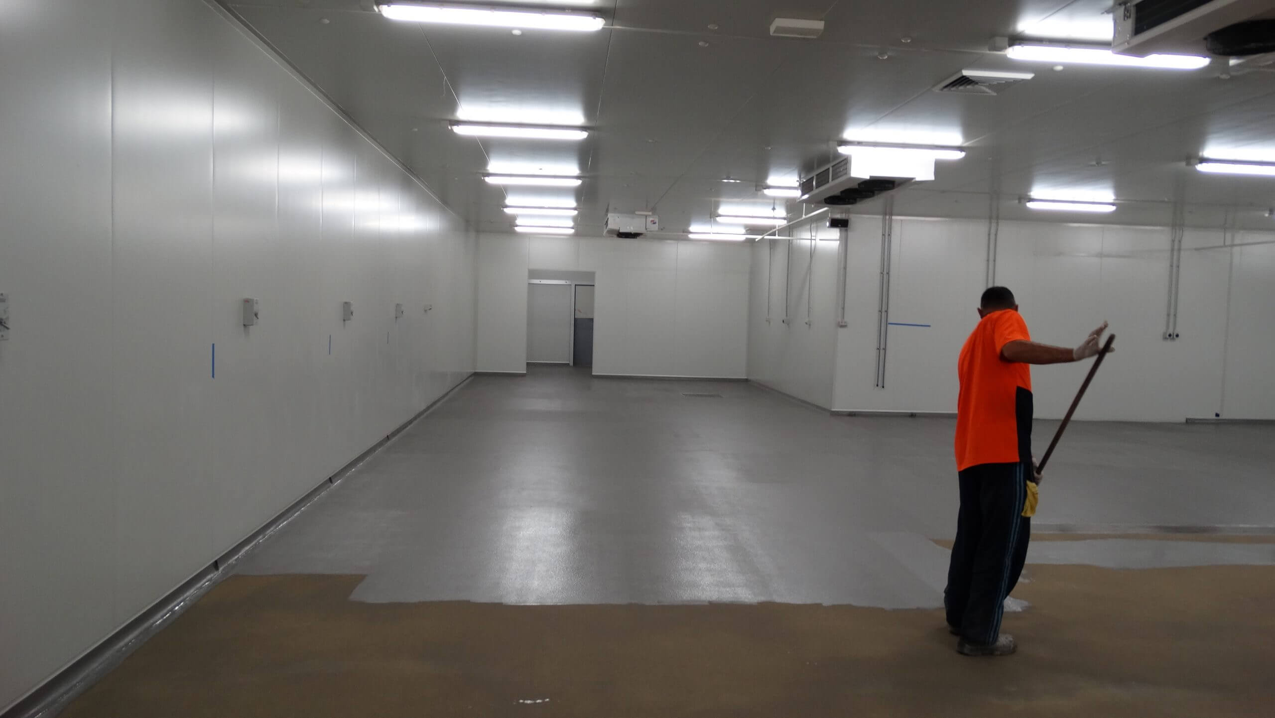 Apllying Flooring Solution - Epoxy Flooring - Remedial Building Services