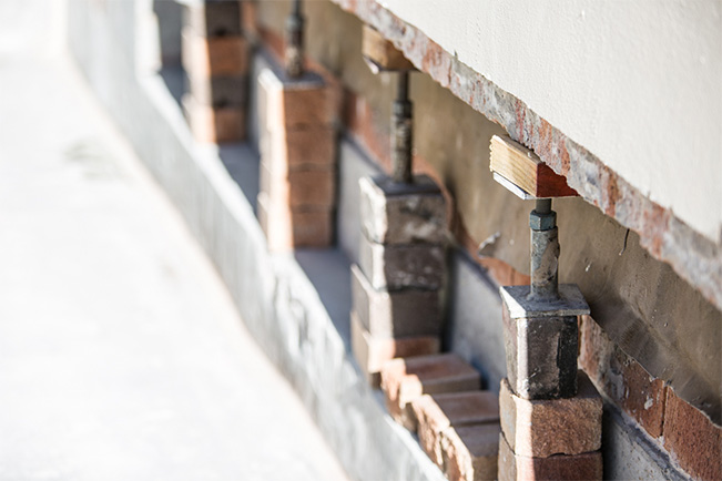 Propping Up A Wall To Treat The Underlying Issues - Concrete Repair - Remedial Building Services