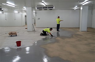 Remedial Team Applying Flooring Coating - Flooring Options - Remedial Building Services