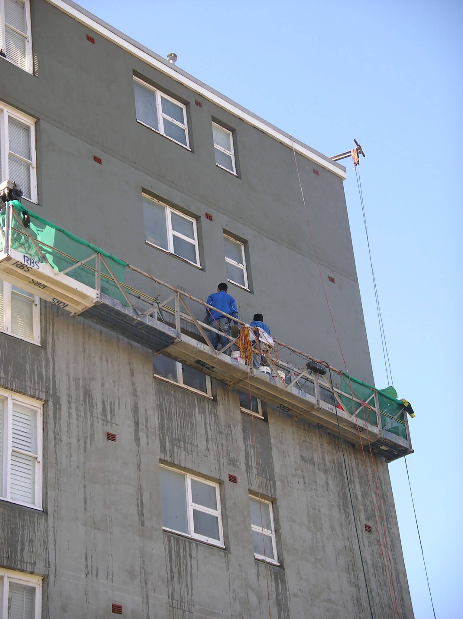 Builder At Scaffolding Plastering Wall - Structural Repair - Remedial Building Services