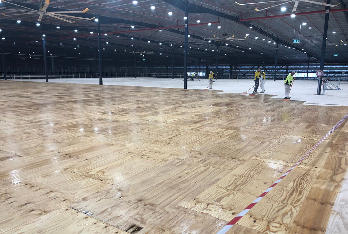 The First Coat Nears Completion On The Mezzanine Floor - Epoxy Flooring - Remedial Building Services
