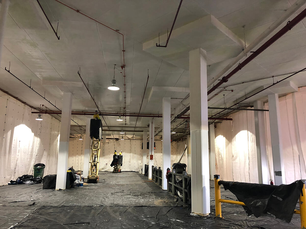 Applying Protective Coatings In Ceiling - Fire Rating Solutions - Remedial Building Services