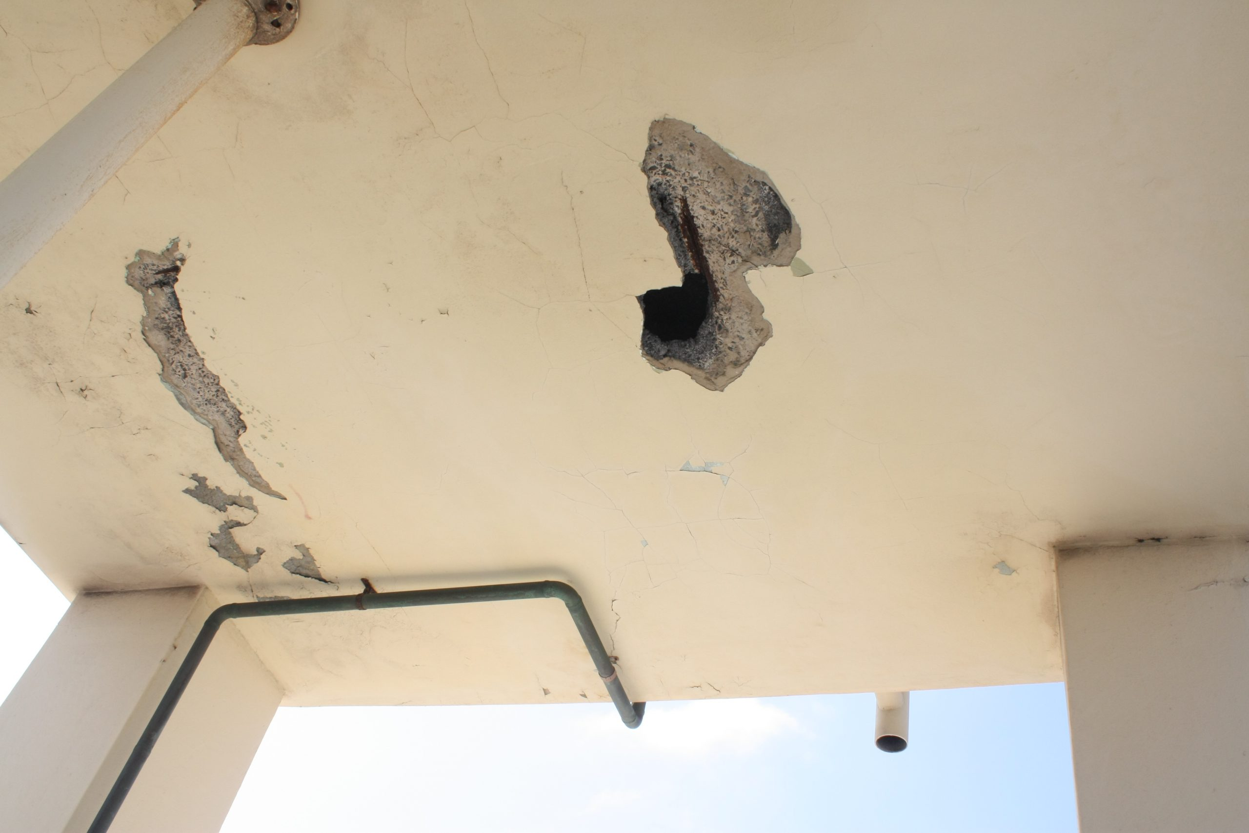 Spalling On Underslide Of Slab - Concrete Repair - Remedial Building Services