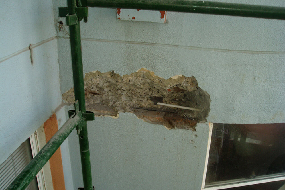 Exposed Reinforcing Bars Under The Surface - Structural Repairs - Remedial Building Services