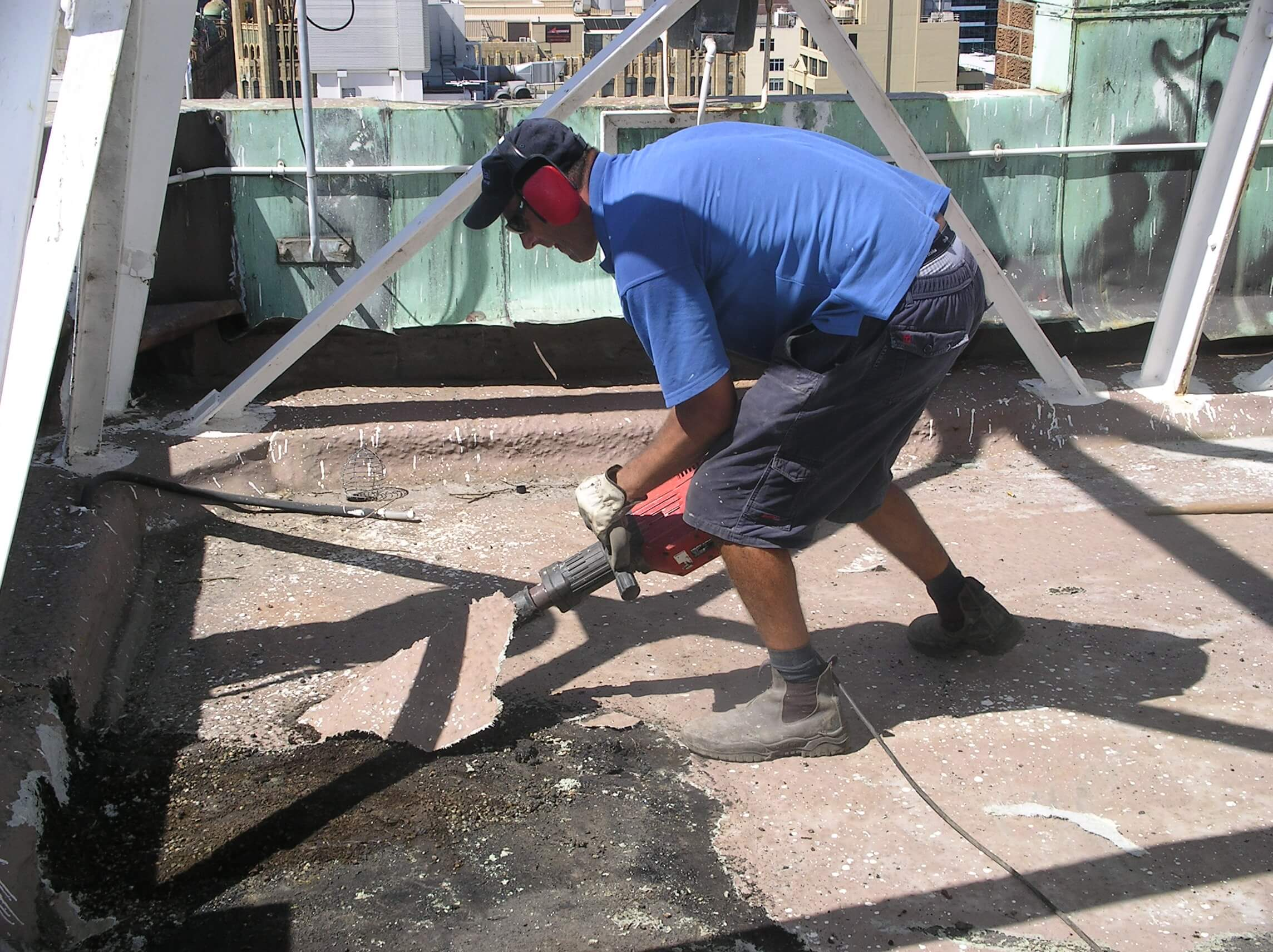 Builder Remove Roofing At AWA Tower - Façade Repair - Remedial Building Services