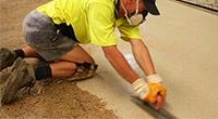 Applying Concrete Floor Coating - Flooring Options - Remedial Building Services