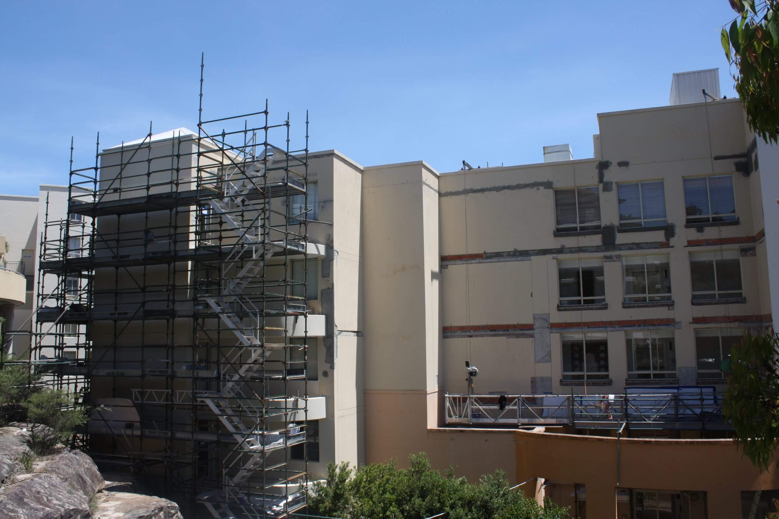 Scaffolding Around The Building For Repair Work - Façade Repair - Remedial Building Services