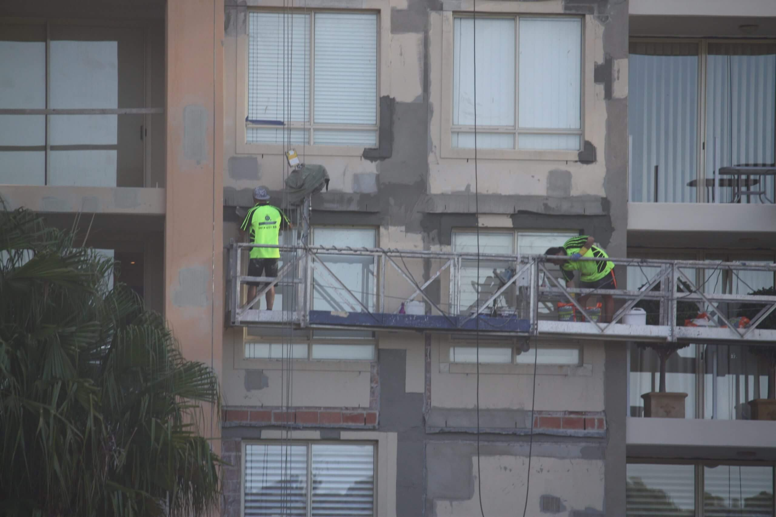 Two Builders On Scaffolding - Water Leakage Problem In Building - Remedial Building Services