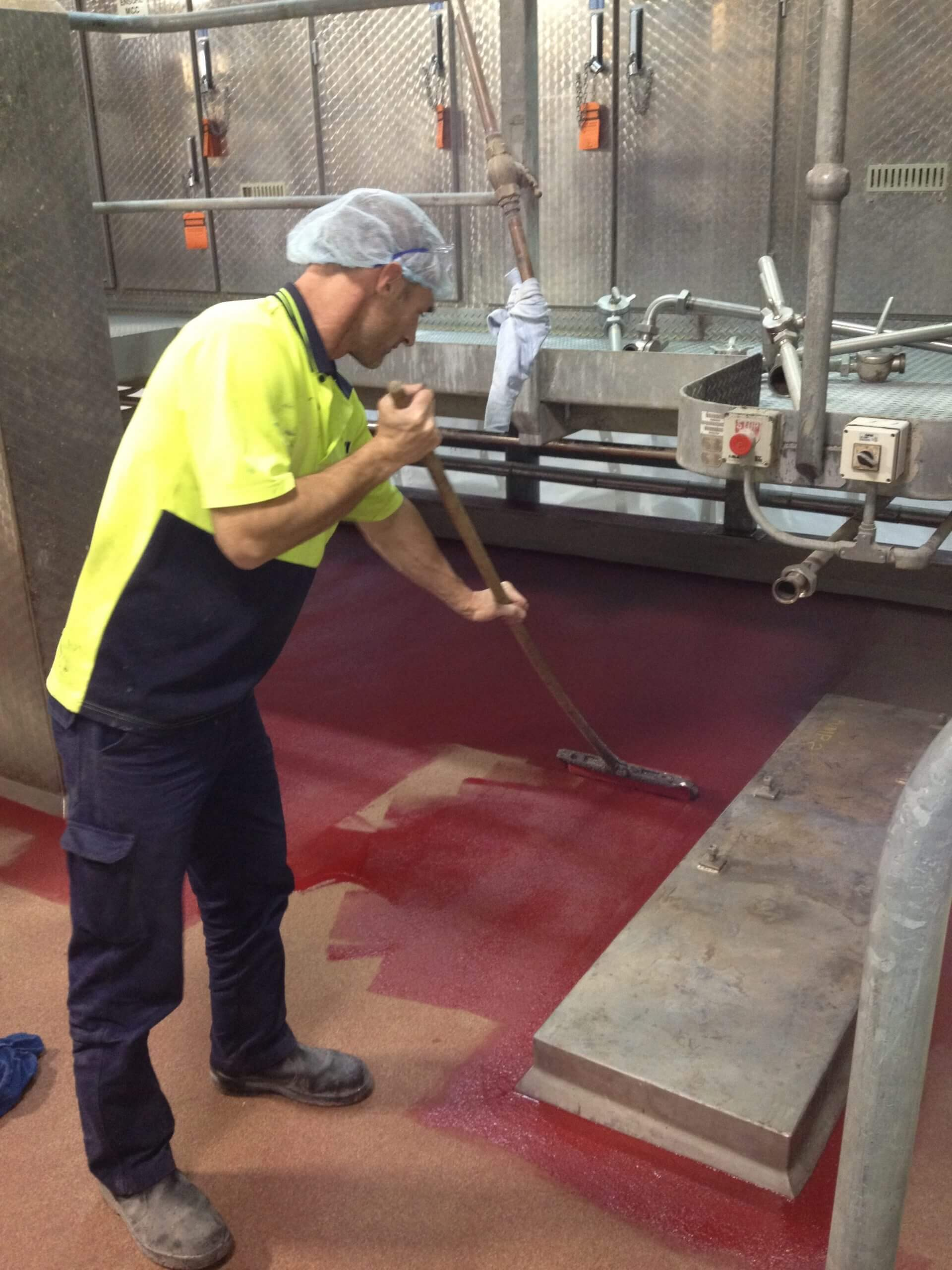 Remedial Team Applying Epoxy Flooring - Flooring Options - Remedial Building Services