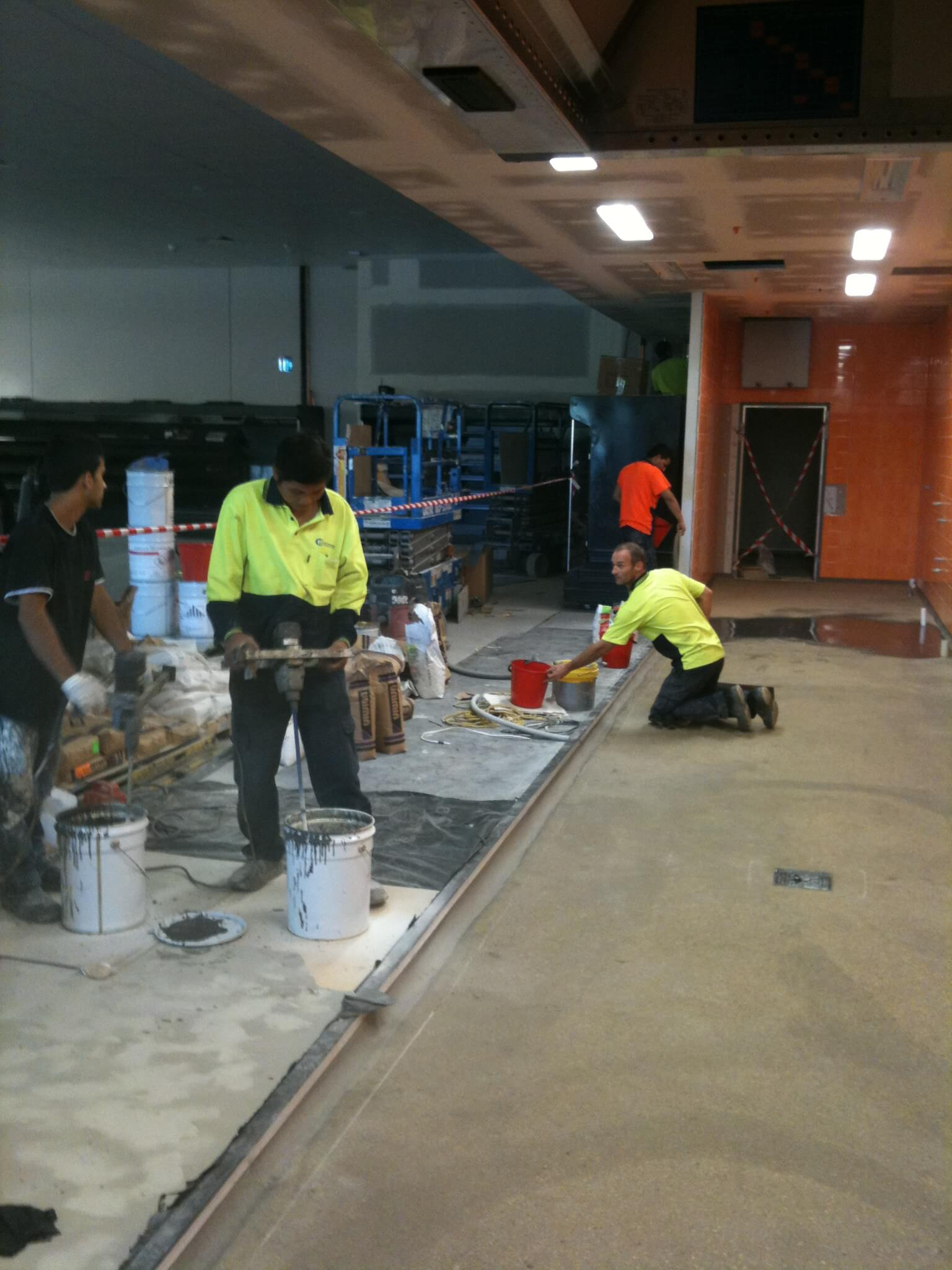 Remedial Team Working On Flooring Surface - Epoxy Flooring - Remedial Building Services
